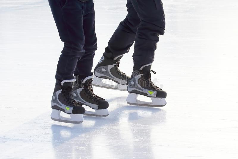 People skating on the ice rink. The people skating on the ice rink royalty free stock photos