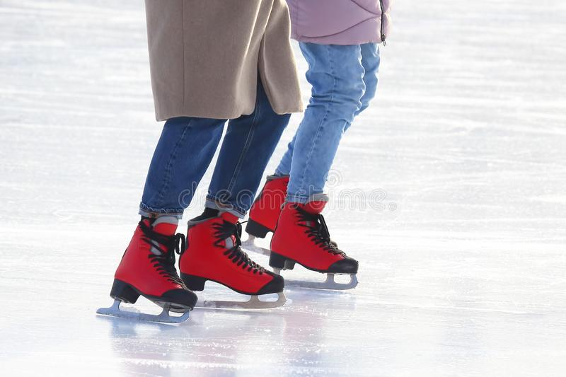 People skating on the ice rink. The people skating on the ice rink stock images