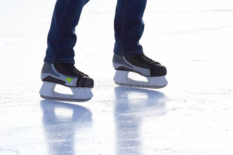 People skating on the ice rink. The people skating on the ice rink stock photo