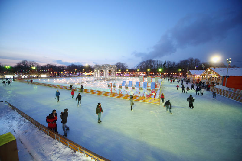People are skating on rink. MOSCOW - Dec 9: People are skating on rink in The Central Park of Culture and Rest named after Maxim Gorky on December 9, 2012 in royalty free stock images