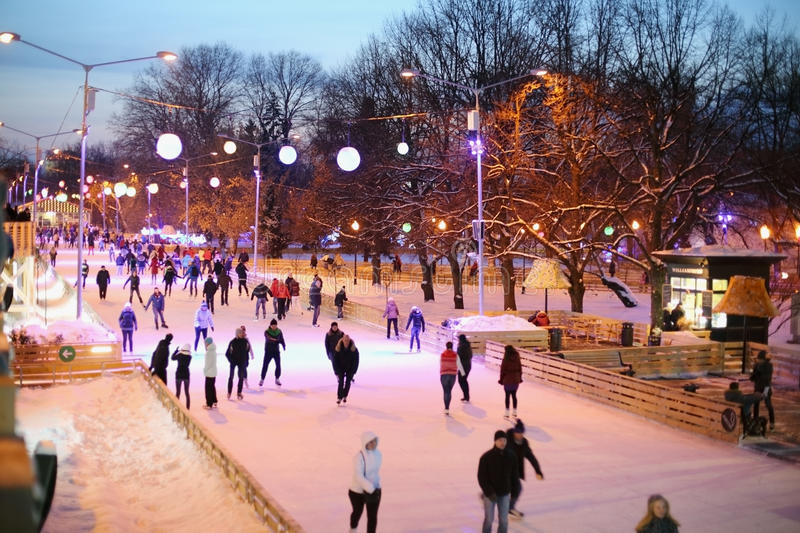People are skating on rink. MOSCOW - Dec 9: People are skating on rink in The Central Park of Culture and Rest named after Maxim Gorky on December 9, 2012 in royalty free stock photography