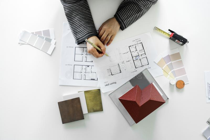 People sketching house plan blueprint stock images