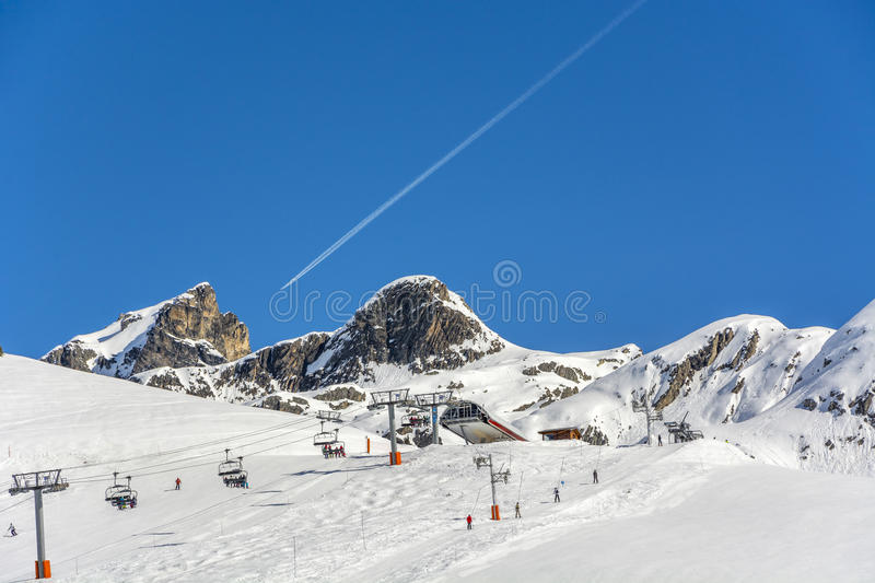 People on ski lift and on the slope. Outdoor shot using natural light in the french Alps stock photography
