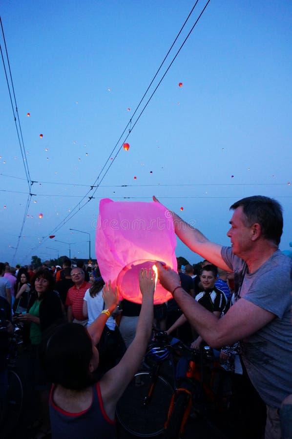 People and sky lanterns on Kupala Night royalty free stock photos