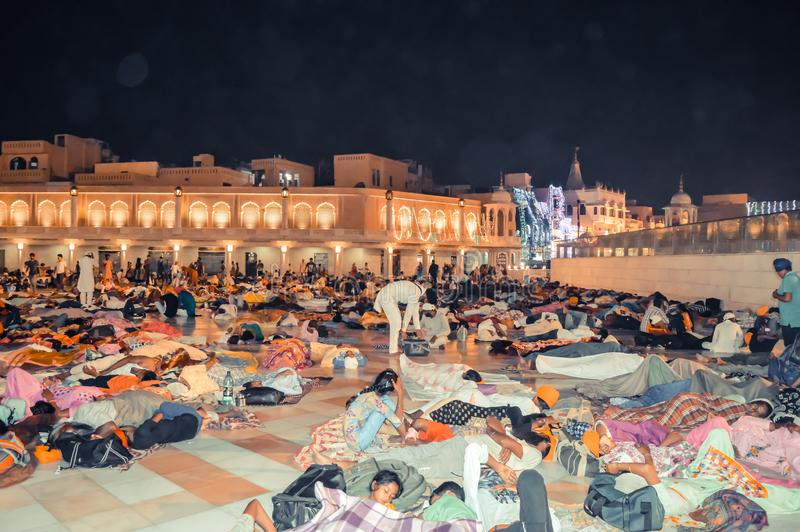 People sleeping on the floor of of the Sikh Golden Temple in Amritsar, India. Amritsar, India - MAY 16 2016: People sleeping on the floor of of the Sikh Golden stock images
