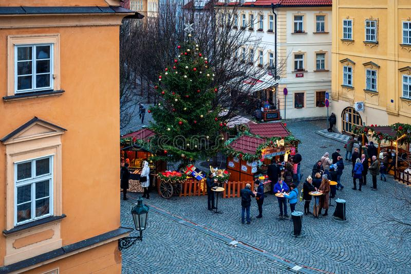 People on small square at Christmas market in Prague. stock photography