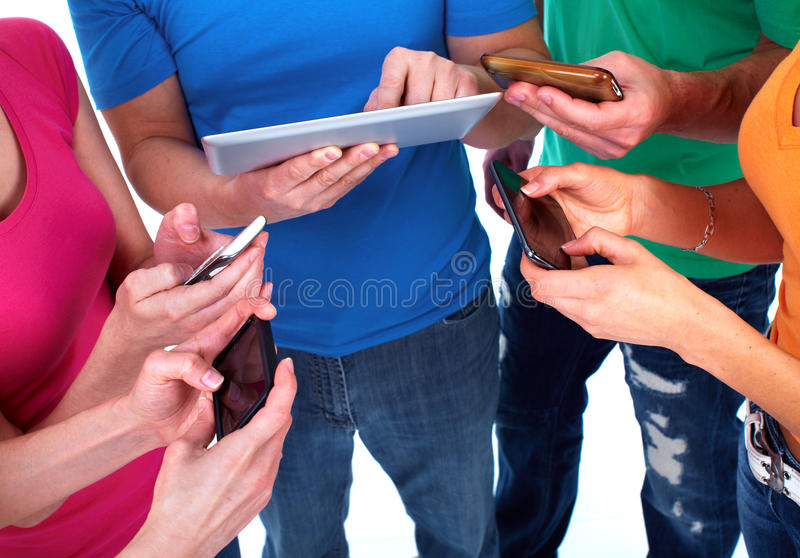 People with smartphones. Group of people with smartphones. Technology stock image