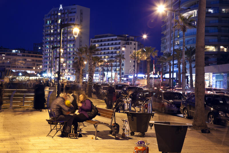 People smoking nargilas in Beirut. People smoking nargilas and seating on Corniche benches facing Mediterranean Sea royalty free stock photo