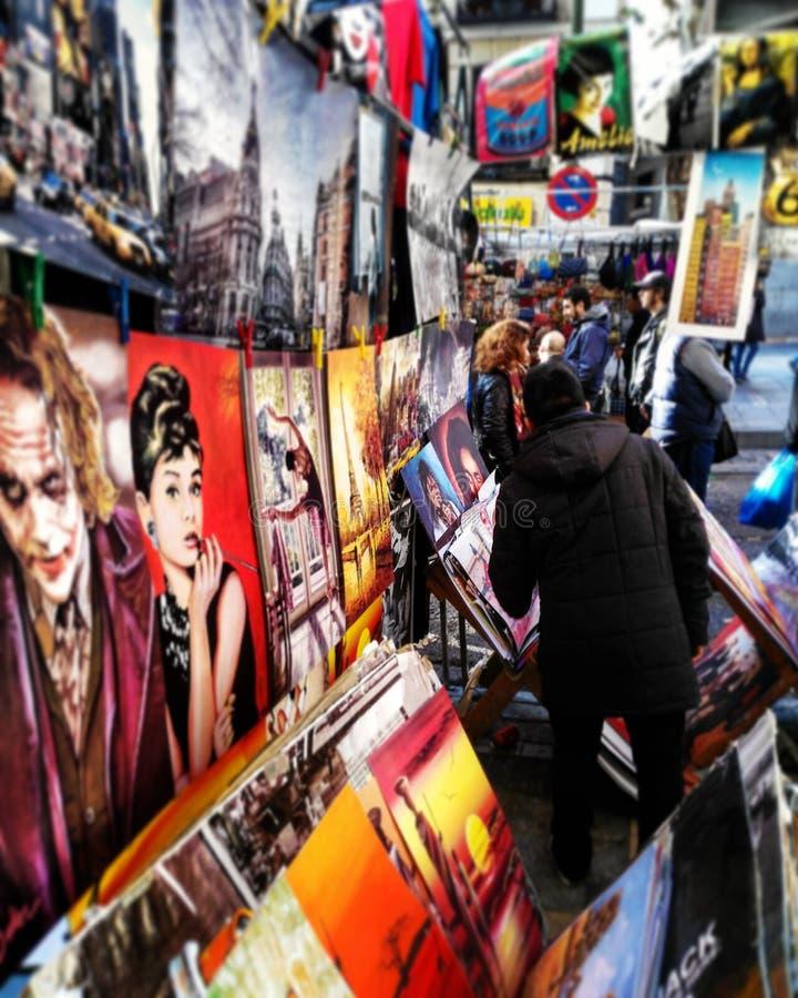 People snooping merchandise in El Rastro of Madrid. royalty free stock photo