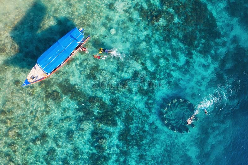 The people are snorkeling near the famous place on Gili Meno Island, Indonesia. Aerial view. Underwater tourism in the ocean. Gili. Meno Island, Indonesia stock images