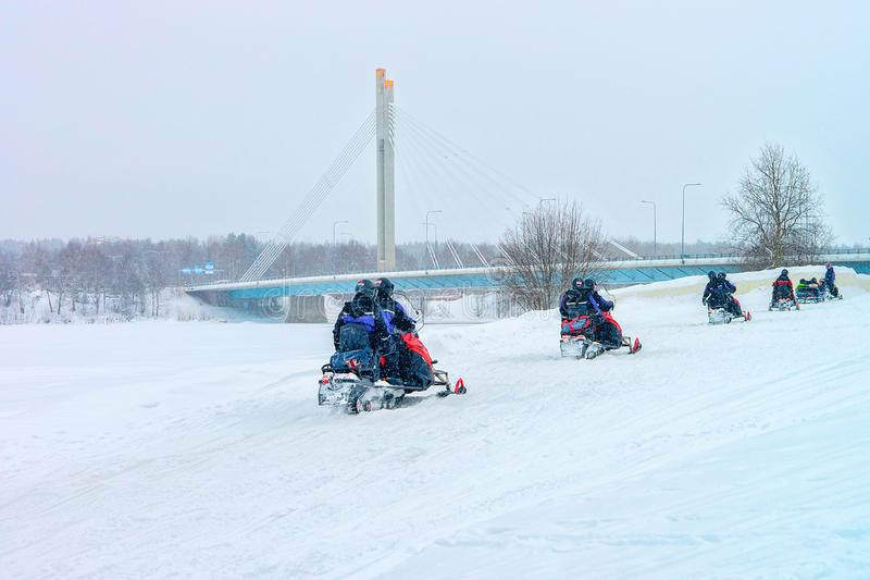 People on Snowmobiles in Winter Finland Lapland in Christmas royalty free stock images