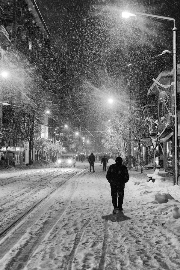 People in snowy winter. People walking in a snowy winter night in city center Eskisehir / Turkey royalty free stock images