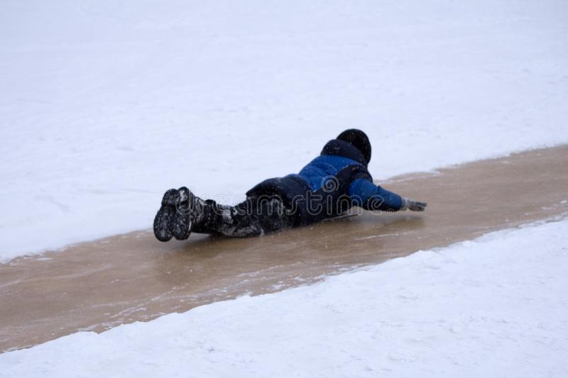 People are specially equipped ice slides during the celebration of the birth of Christ. royalty free stock photography