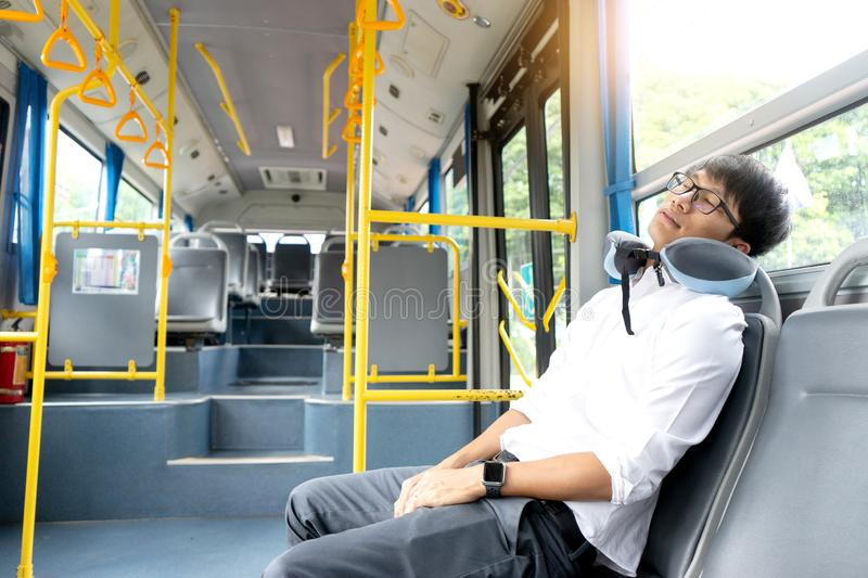 People spend a long time in the bus. It be lifestyle for transpotation in the city and some one get sleep stock photography