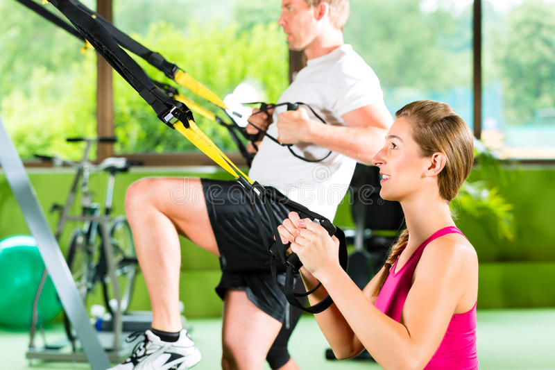 Download People In Sport Gym On Suspension Trainer Stock Image - Image: 28155303