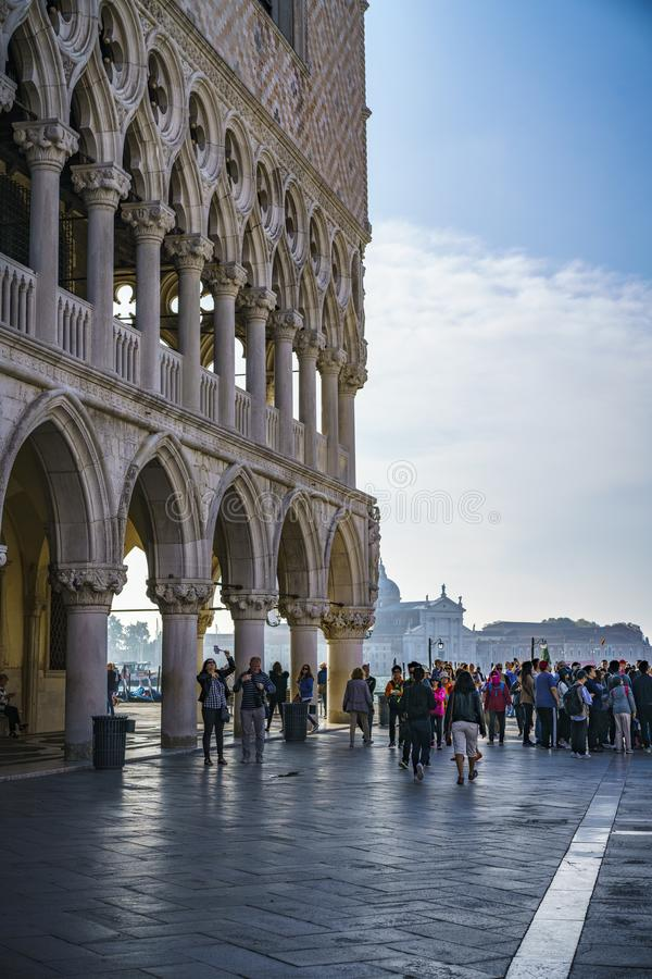 People on the st marks square in front of the doges palace in venice, italy 1. Many people on the st marks square in front of the doges palace in venice, italy royalty free stock image