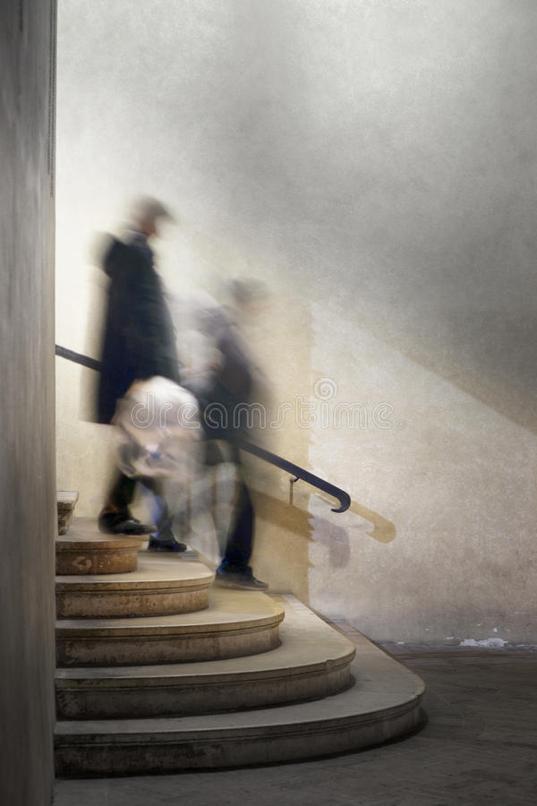 People in staircase stock photos