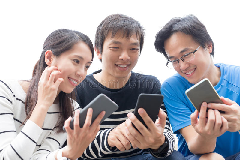 People stake smart phone together. People smile and take smart phone together, asian royalty free stock photography