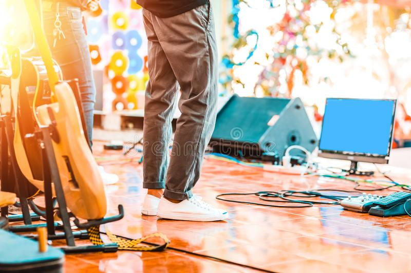 People stand on the music stage at concert stock images