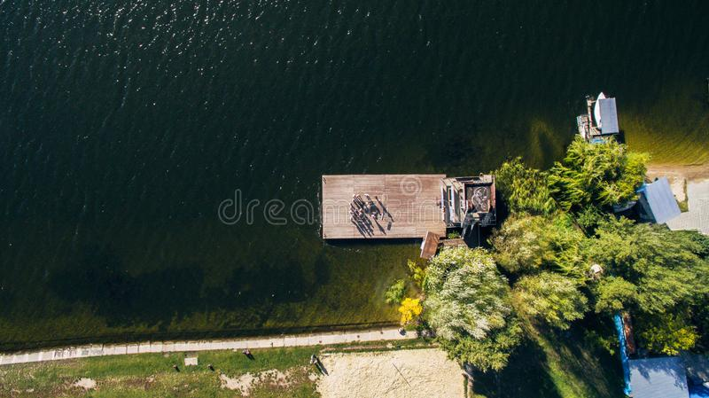 People stand at pier of yacht club, aerial shooting from drone royalty free stock photo