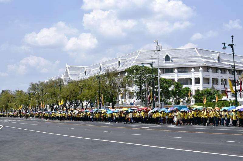 people stand in row to screening point for welcome his majesty the king in coronation of king Rama royalty free stock images