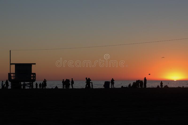 People Standing on Beach stock images