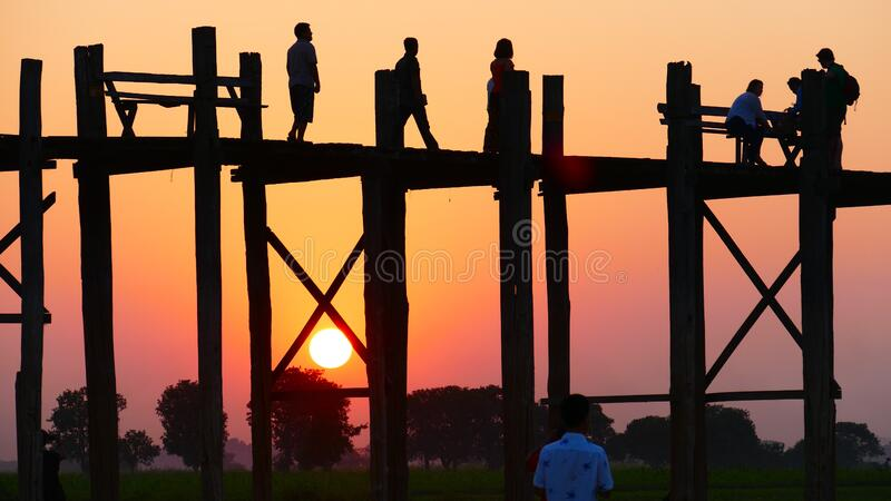 People Standing on a Bridge during Sunset . royalty free stock photos