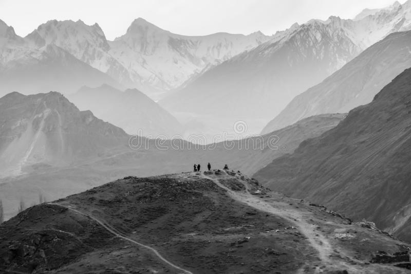 People standing on a hill waiting for rising sun at Hunza valley stock photography