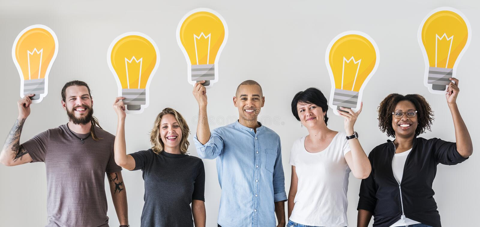 People standing with lightbulb icon royalty free stock images