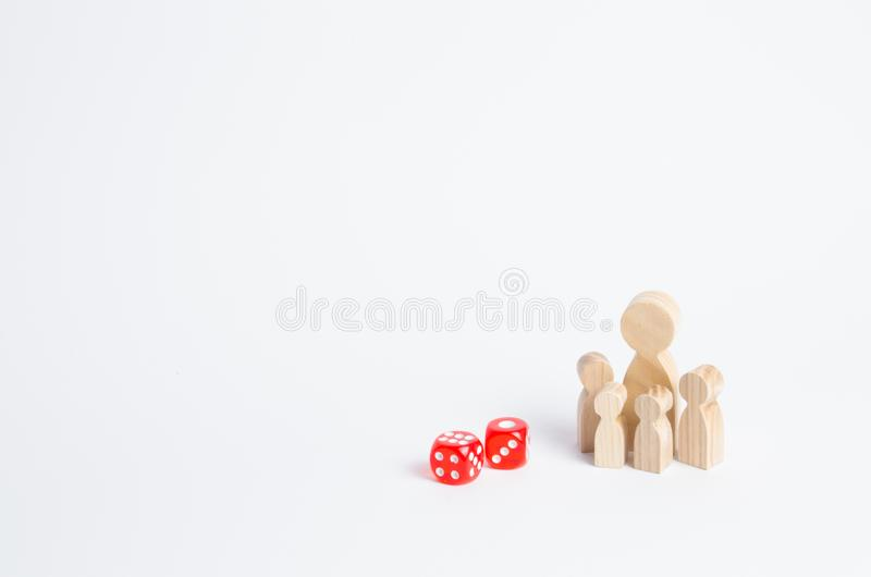 People are standing near dice. The family stands near the dice cubes. The concept of gambling, the dependence on gambling. Destruction of the family. Random royalty free stock photos