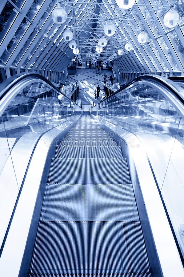 Free People Standing On Escalator In Business Center Stock Images - 9475044