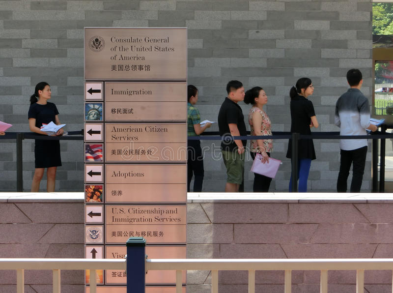 People standing in a queue in front of The Consulate General of United States royalty free stock images