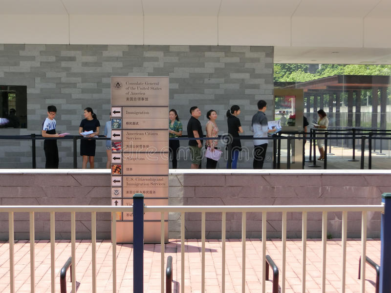 People standing in a queue in front of The Consulate General of United States 2 stock image