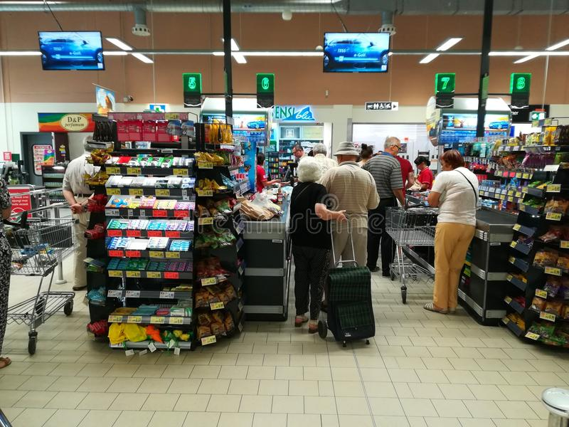 People standing at queue at the supermarket royalty free stock images
