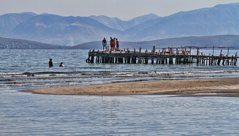 People standing on wooden pier stock images