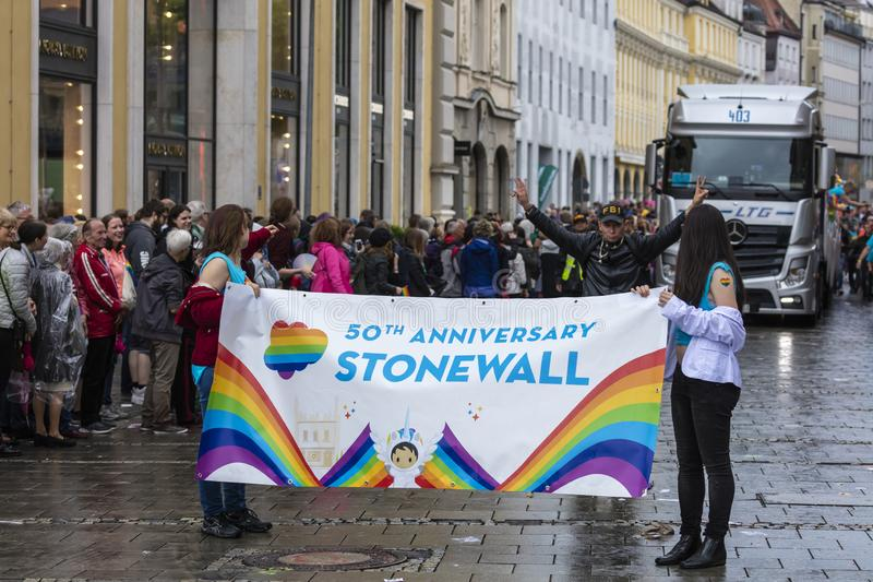 People with a Stonewall banner attending the Gay Pride parade also known as Christopher Street Day CSD in Munich, Germany. 2019: People with a Stonewall banner stock image