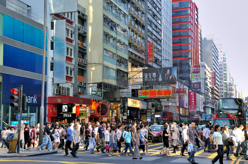People at street accross, Hongkong. View of street in Hongkong, as people at street accross, and buildings, ad board, traffic, shown as various of people living stock photo