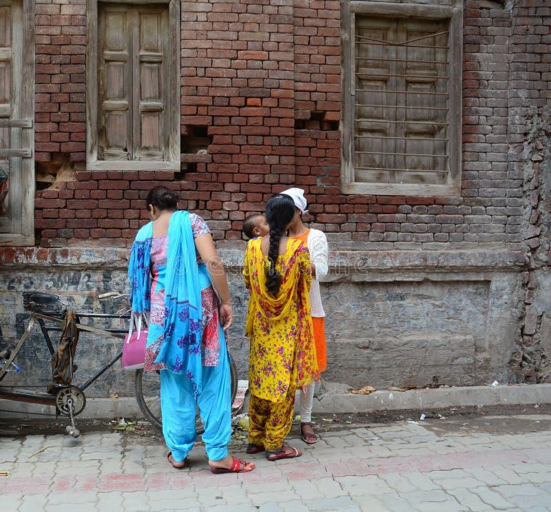 People on street in Amritsar, India. People standing on street in Amritsar, India royalty free stock photos