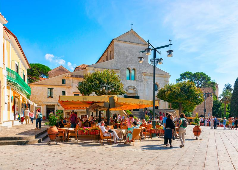 People at street cafe on central square in Ravello village. Ravello, Italy - October 2, 2017: People at street cafe on central square in Ravello village royalty free stock photography