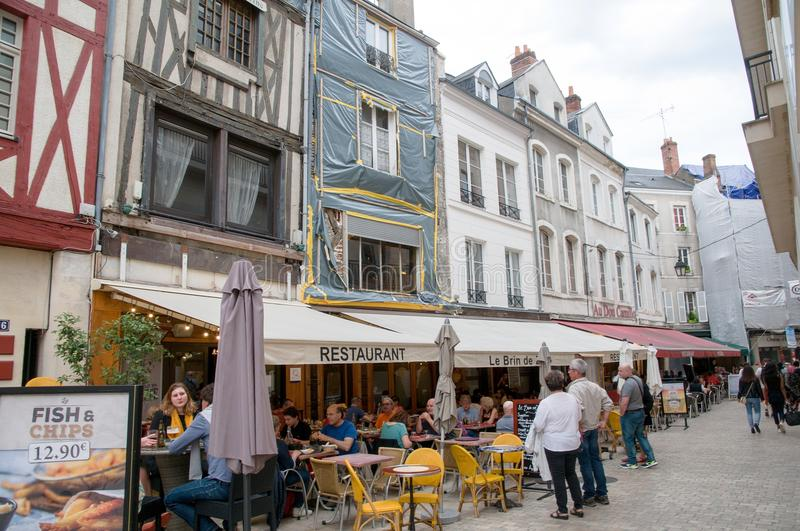 people in a street cafe in orleans france editorial photography image of loire fachwerk. Black Bedroom Furniture Sets. Home Design Ideas