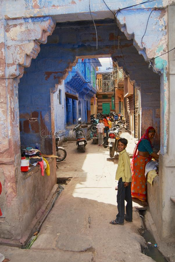 People at the street with historical traditionally blue painted old residential area buildings in downtown Jodhpur, India. Jodhpur, India - April 06, 2007 royalty free stock photo