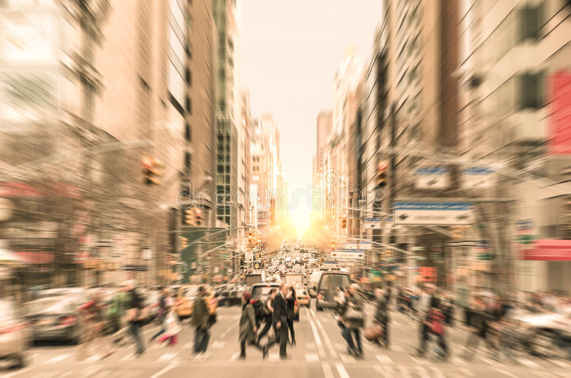 People on the street on Madison Avenue in Manhattan downtown before sunset in New York city - Commuters walking on zebra crossing royalty free stock photo
