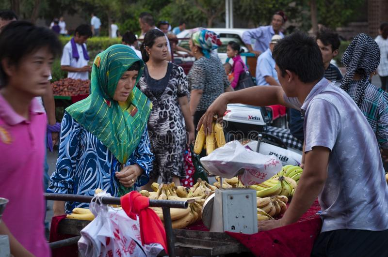 People at a street market in the city of Turpan. Turpan, China - August 10, 2012: People at a street market in the city of Turpan, Xinjiang region royalty free stock photography
