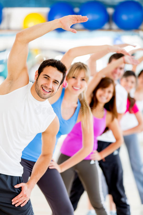 Download People Stretching At The Gym Stock Image - Image of sportive, class: 26034871