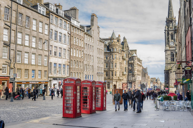 People Strolling along the Royal Mile in Edinburgh on a Cloudy Day stock photo