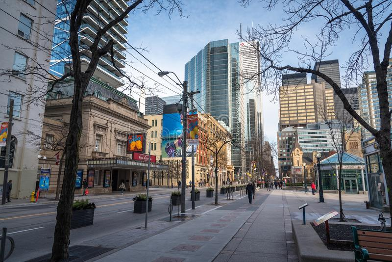 People Strolling Around King St. West in Downtown Toronto on a Sunny Morning stock photos