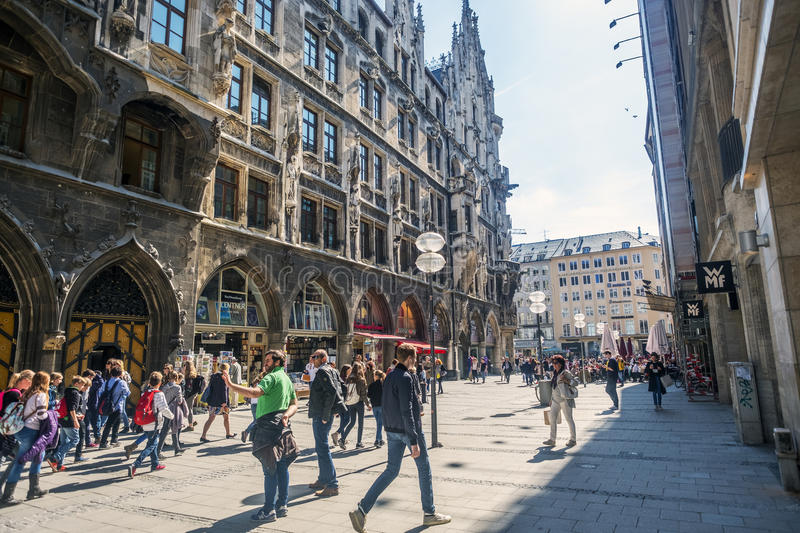 People strolling through Weinstraße next to the Munich City Hal royalty free stock photos