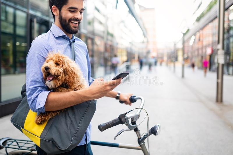 People, style, technology, leisure and lifestyle concept. Happy young man with smartphone on city street stock photo
