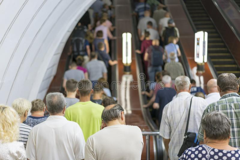 People in the subway on the escalator. A crowd of people on the stairs in the subway.  stock photography