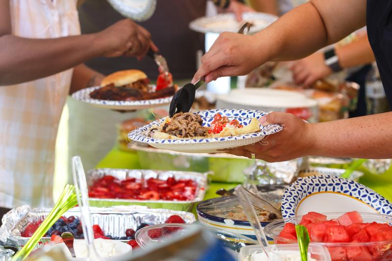People at a Summer Potluck Barbecue stock image